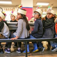 11/16/17 - Serving Thanksgiving Luncheon, Mission Educational Center - Immigrant students watch other students perform while celebrating their first Thanksgiving at Mission Education Center. (Mira Laing/Special to S.F. Examiner)