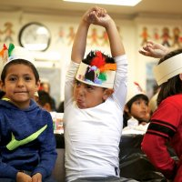 11/16/17 - Serving Thanksgiving Luncheon, Mission Educational Center - An immigrant student makes a silly face at another student during a first Thanksgiving celebration at Mission Education Center. (Mira Laing/Special to S.F. Examiner)