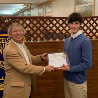 1/16/19 - Club Student Speaker Contest - Lion Paul Corvi presenting a certificate to winner Michael Gray from Riordan High School.