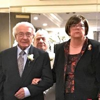 8/10/18 - Cabinet Installation, San Mateo Marriott @ S. F. Airport - Lion Joe Farrah escorting Incoming Zone Chairman Lion Sharon Eberhardt. They are about to be called and enter the Cabinet Installation. They are flanked by Lion PDG Ray Rosenthal of the Foster City Lions.