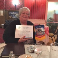 8/15/18 - Italian American Social Club - Lion Denise Kelly showing off her Certificate of Appreciation and club banner following her presentation on the North Peninsula Food Pantry & Dining Center in Daly City.