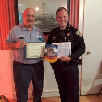9/19/18 - Guest speaker SFPD Capt. Jack Hart, Italian American Social Club - Lion President George Salet with Capt. Jack Hart, both displaying Certificates of Recognition received and Club banner.