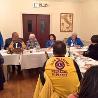 10/17/18 - District Governor's Visitation, Italian American Social Club - L to R outside of table: Lions District Governor Lydia Taylor-Bellinger, President George Salet, Secretary Joe Farrah, 1st Vice District Governor Helen Ariz Casaclang, Cabinet Secretary Denise Kelly, and Sharon Eberhardt. Inside table: Lion Bill Graziano (gray shirt), and visiting Lion Hernaldo Martinez from Pedregal, Panama (in vest.) Lion Cabinet Secretary Denise Kelly clarifying some info during the Governor's remarks.