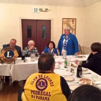 10/17/18 - District Governor's Visitation, Italian American Social Club - L to R outside of table: Lions District Governor Lydia Taylor-Bellinger, President George Salet, Secretary Joe Farrah, 1st Vice District Governor Helen Ariz Casaclang, Cabinet Secretary Denise Kelly, and Sharon Eberhardt. Inside table: visiting Lion Hernaldo Martinez from Pedregal, Panama (in vest.) Lion Cabinet Secretary Denise Kelly talking about District events and the new polo shirts for the District.