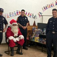 12/18/18 - Los Bomberos Firefighters with Santa at Mission Education Center - Santa and crew ready for the students to arrive.
