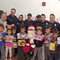 12/18/18 - Los Bomberos Firefighters with Santa at Mission Education Center - Santa, and crew, with the second grade class.