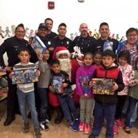 12/18/18 - Los Bomberos Firefighters with Santa at Mission Education Center - Santa, and crew, with the third grade class.