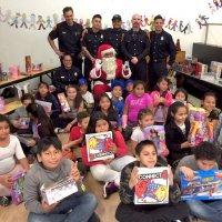 12/18/18 - Los Bomberos Firefighters with Santa at Mission Education Center - Santa, and crew, with the fifth grade class.