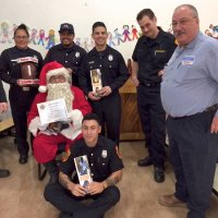 12/18/18 - Los Bomberos Firefighters with Santa at Mission Education Center - Some of Santa's crew, with Lion President George Salet after presentation of a Certificate of Appreciation for their help.