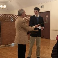 1/15/20 - Student Speaker Contest at the I.A.S.C - Lion Chairman Paul Corvi presenting winner's check and certificate to Michael Gray. Lion Bob Fenech on the right.