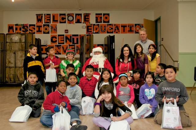 Students with Santa and his Staff